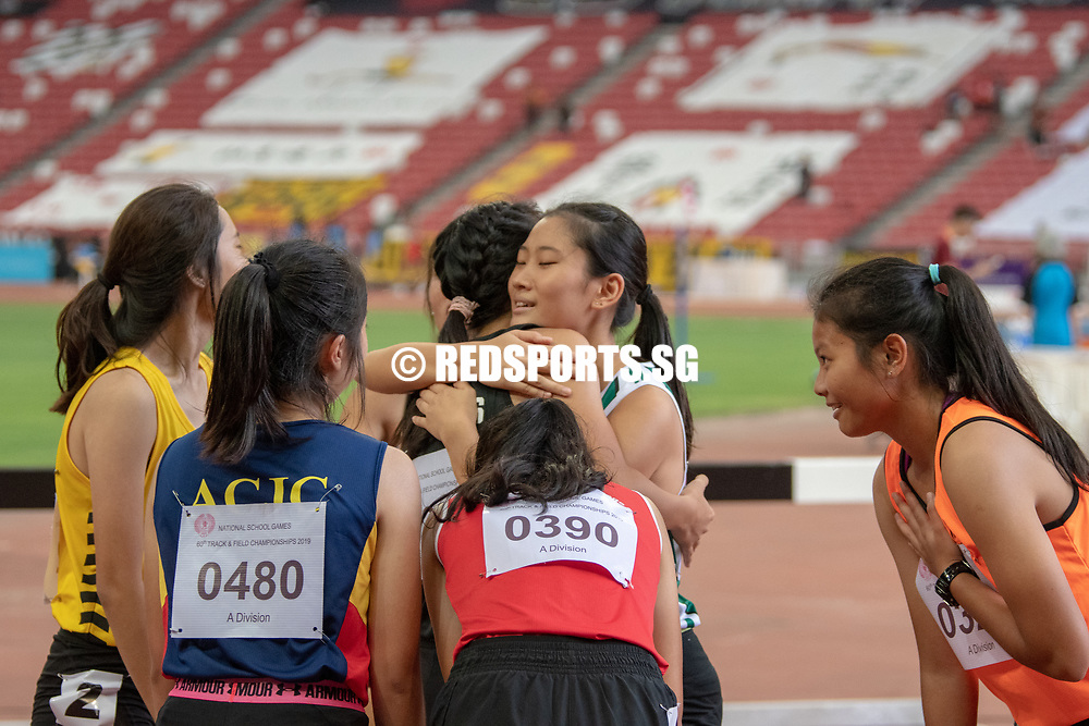 Valencia Ho (#410) of RI and Natalie Shek (#434) of St. Joseph's Institution (international) embrace after the A Division Girls' 100m hurdles final. (Photo X © REDintern Jared Khoo)