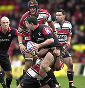 Watford, GREAT BRITAIN, 3rd April 2004, Vicarage Road, ENGLAND. [Mandatory Credit: Photo  Peter Spurrier/Intersport Images],<br /> 03/04/2004  - 2003/04 Zurich Premiership - Saracens v Gloucester<br /> Kevin Sorrell is caught with the ball,and looks for support, by the tackle from AndyHazell