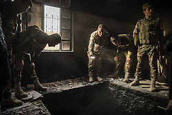 October 18, 2016 - Mosul, Iraq - NO SUBSCRIBTIONS ***..The battle of Mosul. Kurdish Peshmerga forces inspect a tunnel inside an abandoned house in the outskirts of Mosul, Iraq, recaptured from the Islamic State (IS) jihadists by Kurdish Peshmerga and Iraqi forces (Credit Image: © AftonbladetIBL via ZUMA Wire)