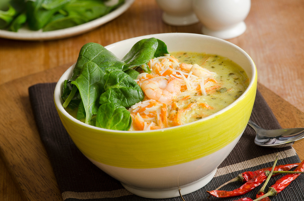 A spicy fragrant prawn laksa soup topped with spinach