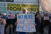 """Bob Murry from Texas holds a sign saying, """"No more Hate, lies, Racism"""" at the Vote Out the Scandal rally at Hachiko Square, Shibuya, Tokyo, Japan. Sunday November 5th 2017. Timed to coincide with President Trumps visit to Japan, About 120 Americans living in Japan and some local Japanese  protested together from 2pm to 4pm to encourage US citizens to register to vote in future elections and call on the US government to honour it responsibilities to the American people,."""