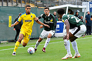 Tennai Watson (2) of AFC Wimbledon battles for possession with Ruben Lameiras (11) of Plymouth Argyle during the EFL Sky Bet League 1 match between Plymouth Argyle and AFC Wimbledon at Home Park, Plymouth, England on 6 October 2018.
