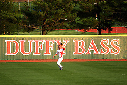21 April 2015:  Sean Beesley lines up under a high hit ball shielding his eyes in the late day sun during an NCAA Inter-Division Baseball game between the Illinois Wesleyan Titans and the Illinois State Redbirds in Duffy Bass Field, Normal IL
