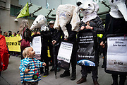 A young girls smiles at climate activists from Exctinction Rebellion dressed as endangered animals as they occupy the forecourt of BBC New Broadcasting House during day five of two weeks of planned demonstrations on 11th October, 2019 in London, United Kingdom. Extinction Rebellion accuse the BBC of staying silent and demand they tell the full truth about the climate crisis.