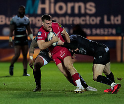 Scarlets' Gareth Davies under pressure from Toulon's Chris Ashton<br /> <br /> Photographer Simon King/Replay Images<br /> <br /> European Rugby Champions Cup Round 6 - Scarlets v Toulon - Saturday 20th January 2018 - Parc Y Scarlets - Llanelli<br /> <br /> World Copyright © Replay Images . All rights reserved. info@replayimages.co.uk - http://replayimages.co.uk