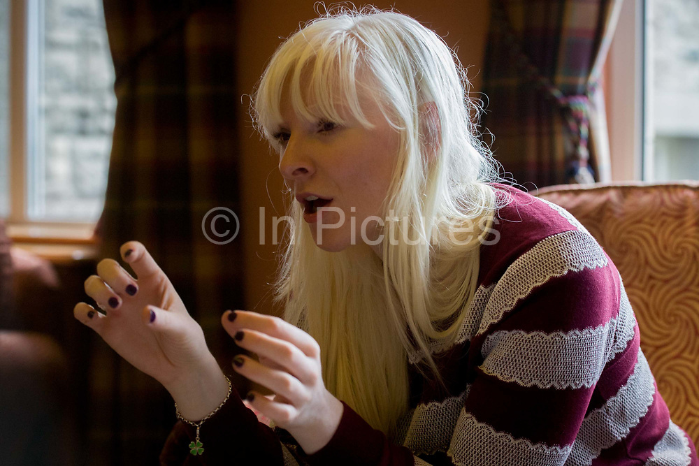 Partially-sighted skiing paralympian from the Sochi Olympics, Kelly Gallagher, Belfast, Northern Ireland. Talking in an interview situation she makes a point using her hands. From the chapter entitled 'The Law of Gravity' and from the book 'Risk Wise: Nine Everyday Adventures' by Polly Morland (Allianz, The School of Life, Profile Books, 2015).