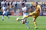 Newport's Daniel Butler (r) clears under pressure from Mansfield's Danny Rose. Skybet EFL league two match, Newport county v Mansfield Town at Rodney Parade in Newport, South Wales on Saturday 6th August 2016.<br /> pic by Carl Robertson, Andrew Orchard sports photography.