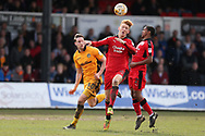 Josh Yorwerth of Crawley Town gets to a header ahead of Newport's Ryan Bird (l).  EFL Skybet football league two match, Newport county v Crawley Town at Rodney Parade in Newport, South Wales on Saturday 1st April 2017.<br /> pic by Andrew Orchard, Andrew Orchard sports photography.