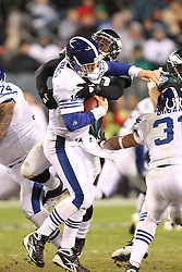 PHILADELPHIA - NOVEMBER 7: Quarterback Peyton Manning #18 of the Indianapolis Colts is sacked by linebacker Ernie Sims #50 of the Philadelphia Eagles during a game on November 7, 2011 at Lincoln Financial Field in Philadelphia, Pennsylvania. The Eagles won 26-24. (Photo by Hunter Martin/Getty Images) *** Local Caption *** Peyton Manning;Ernie Sims