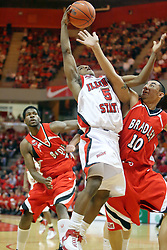 """03 February 2007: Keith """"Boo"""" Richardson and J.J. Tauai fight for a rebound. In what is locally referred to as the War on Seventy Four, the Bradley Braves defeated the Illinois State University Redbirds 70-62 on Doug Collins Court inside Redbird Arena in Normal Illinois."""