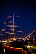 Historic boat on the Landungsbrücken harbourside at night, on the Elbe, Hamburg, Germany.