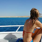 Girl on board a yacht in Red Sea near Naama Bay, Sharm El-Sheikh, Sinai, Egypt