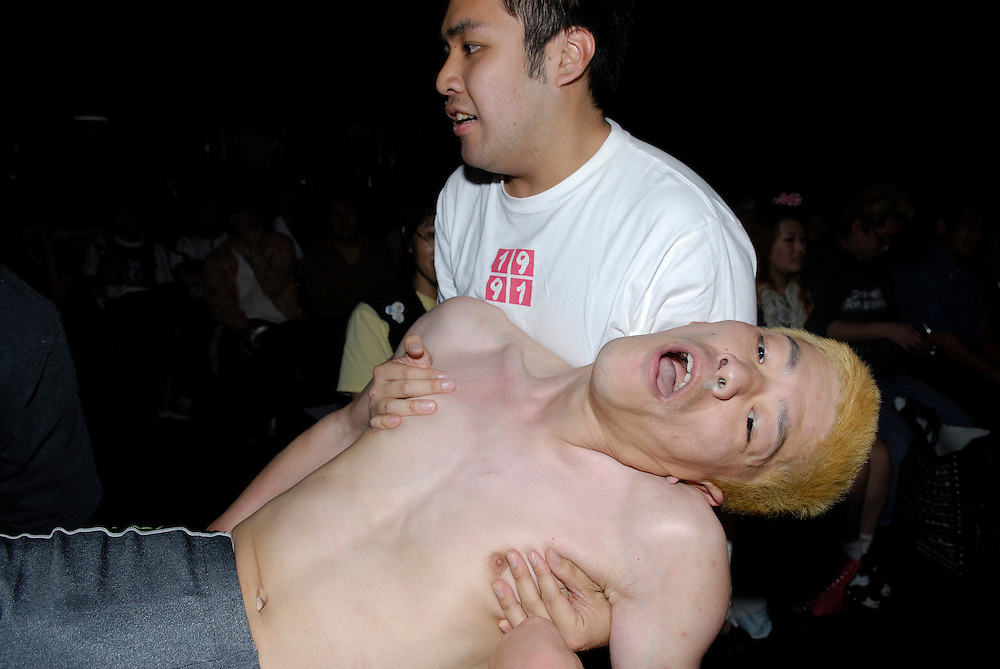 """Yasuhiro Kayahara, AKA """"No Sympathy""""  is helped out of the ring."""