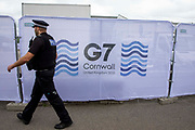 A police officer patrolling the streets around the G7 media centre on the 11th of June 2021 in Falmouth in Cornwall, United Kingdom. Over 5000 police officers from forces across the UK are in Cornwall this weekend for the G7 world leaders summit.
