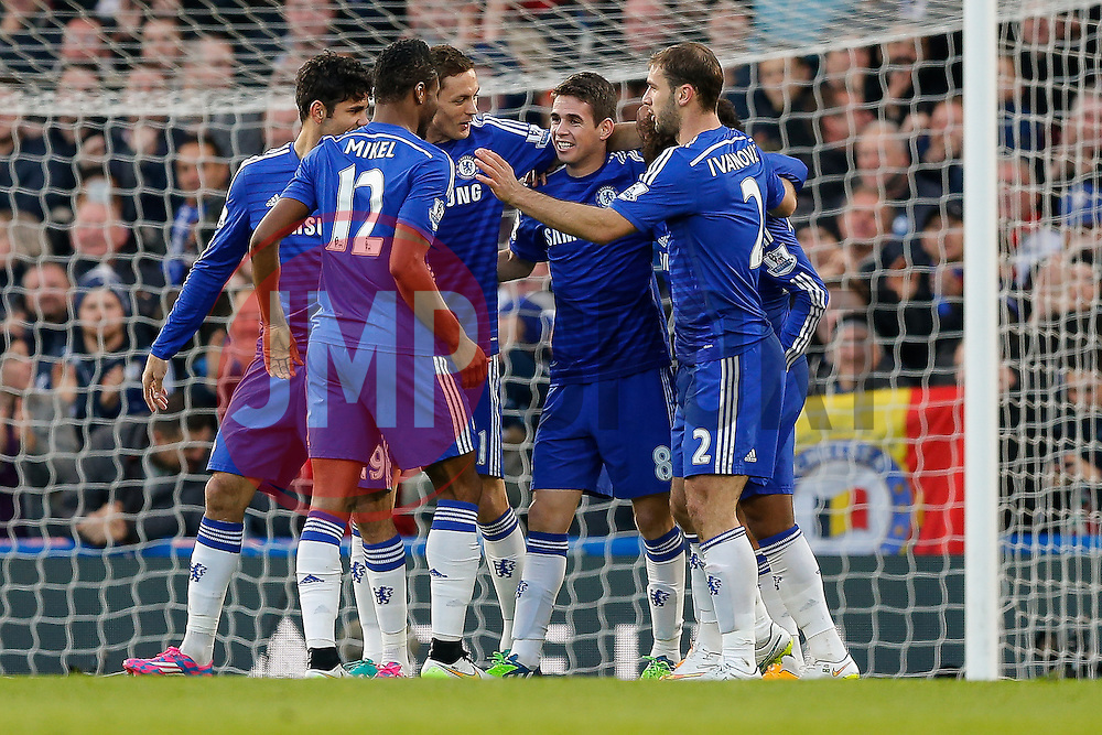 Chelsea players celebrate after Eden Hazard scores a goal to make it 1-0 - Photo mandatory by-line: Rogan Thomson/JMP - 07966 386802 - 13/12/2014 - SPORT - FOOTBALL - London, England - Stamford Bridge - Chelsea v Hull City - Barclays Premier League.