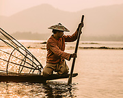 """One of the Intha fishermen on Lake Inle (Intha meaning """"sons of the lake""""). A hugely popular region for tourism the lake and region is facing major challenges to ensure that the waters are properly managed and that many of the traditional tribes are not pushed out."""