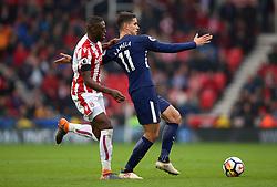 Tottenham Hotspur's Erik Lamela is pulled back by Stoke City's Bruno Martins Indi