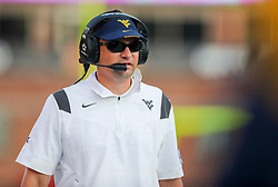 Sep 4, 2021; College Park, Maryland, USA; West Virginia Mountaineers head coach Neal Brown walks down the sidelines during the fourth quarter against the Maryland Terrapins at Capital One Field at Maryland Stadium. Mandatory Credit: Ben Queen-USA TODAY Sports