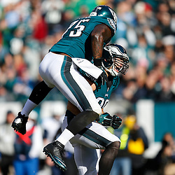Philadelphia Eagles outside linebacker Connor Barwin #98 is congratulated by defensive end Vinny Curry #75 after a play during the NFL game between the Tennessee Titans and the Philadelphia Eagles at Lincoln Financial Field in Philadelphia, Pennsylvania on Sunday November 16th 2014. The Eagles won 43-24. (Brian Garfinkel/Philadelphia Eagles)