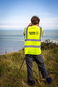 A group of Channel Rescue volunteers monitor the English Channel using telescopes and binoculars searching for small boats of people migrating across from France and mainland Europe on the 29th of September 2020 on the White Cliffs of Dover, United Kingdom. Formed in the summer of 2020 Channel Rescue are Human Rights Observers concerned about the demonisation of the men, women, and children migrating across the English Channel risking their lives to arrive on the UK shores. (photo by Andy Aitchison)