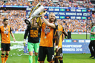David Meyler of Hull City poses with the Sky Bet Championship Playoff Trophy.Skybet football league Championship play off final match, Hull city v Sheffield Wednesday at Wembley Stadium in London on Saturday 28th May 2016.<br /> pic by John Patrick Fletcher, Andrew Orchard sports photography.