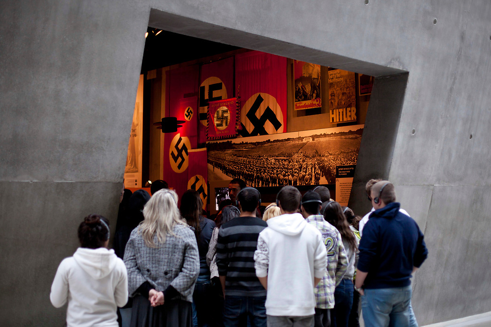 Visitors view an exhibit at the Yad Vashem Holocaust memorial in Jerusalem on the International Holocaust Remembrance Day on January 27, 2011. The International Holocaust Remembrance Day is designated by the United Nations General Assembly to commemorate the victims of Holocaust.
