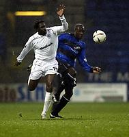 Photo. Aidan Ellis.<br />Bolton Wanderers v Gillingham.<br />Carling Cup 3rd Round.<br />28/10/2003.<br />Bolton's Ibrahim Ba and Gillingham's Nayron Nosworthy