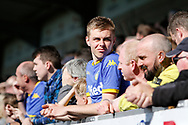 Leeds United fan enjoys the sun at the Pirelli stadium during the EFL Sky Bet Championship match between Burton Albion and Leeds United at the Pirelli Stadium, Burton upon Trent, England on 22 April 2017. Photo by Richard Holmes.