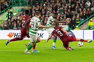 Odsonne Edouard has a shot blocked by Andrei Burca during the Europa League match between Celtic and CFR Cluj at Celtic Park, Glasgow, Scotland on 3 October 2019.