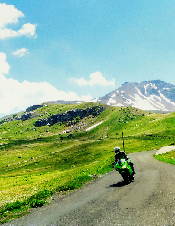 The French Alps are absolutely beautiful and the roads there are both challenging and rewarding.  Here a Kawasaki rider enjoys the curves of the Col d'Cayole.