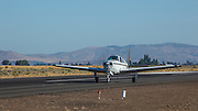 Scott Sclocum's Beechcraft Bonanza A36, our camera plane for the weekend, taking off on a photo flight.