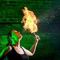 Picture shows :  Ailsa Longmuir  (in black) ...Writer Ailsa Longmuir  (in black) learns the Art of Fire Breathing / Fire Eating with her first  lesson from the Purple Productions team of Rufus T. Fahrenheit and Lucille Burn (animal print)....Picture Drew Farrell Tel : 07721-735041.