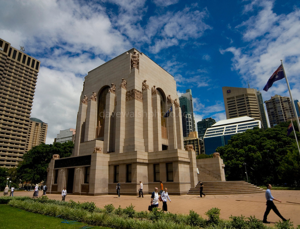 """ANZAC War Memorial, Sydney, Australia. Finished in 1934 after designs and art by C. Bruce Dellit and sculptor Rayner Hoff, it commemorates the Australian War dead of World War One. ..Many of the original sculptures didn't make it in the memorial, thanks to censure by the Catholic church, and its bishop, Michael Sheehan. .. The sculpture that caused the sensation, The Crucifixion of Civilisation, is pictured below. It is shocking. A naked figure on a cross, a young woman, sits atop a pyramid of broken soldiers, corpses, weapons, helmets, the debris of battle. The detail is hyper-real and brilliantly executed. Hoff described the symbolism of his central figure: """"Adolescent Peace is depicted crucified on the armaments of the ravisher, the war god, Mars. The Greek helmet animalistically gapes over the head of expiring Peace, the cuirass of the body armour hard and brutal in contrast to her lithe woman's body.""""..Lithe women's bodies have always caused problems for the Catholic Church, and Hoff's depictions of the human body were intrinsically sensual. (His famous 1924 sculpture, Faun and Nymph, part of the collection of the Art Gallery of NSW, is basically pornographic.) This particular lithe naked woman was especially problematic...The Catholic archbishop of Sydney, Michael Sheehan, announced that he would not be attending the laying of the foundation stone on July 19, 1932. The memorial, he said, was """"obviously intended only for Protestants"""". As for the young woman on the cross, this image was """"gravely offensive to ordinary Christian decency""""..http://www.smh.com.au/articles/2004/04/18/1082226632478.html?from=storyrhs."""