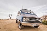 Automotive photographer Raymond Rudolph photographs a vintage Dodge Tradesman van in the Mojave Desert