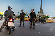 26 MAY 2014 - BANGKOK, THAILAND:  Thai soldiers on duty around Victory Monument after an anti-coup protest broke up. About two thousand people protested against the coup in Bangkok. It was the third straight day of large pro-democracy rallies in the Thai capital as the army continued to tighten its grip on Thai life.  PHOTO BY JACK KURTZ