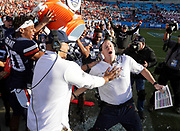 ANDREW SHURTLEFF/THE DAILY PROGRESS <br /> Virginia head coach Bronco Mendenhall is doused with water in the final moments of the Belk Bowl Saturday in Charlotte, NC. Virginia defeated South Carolina  28-0.