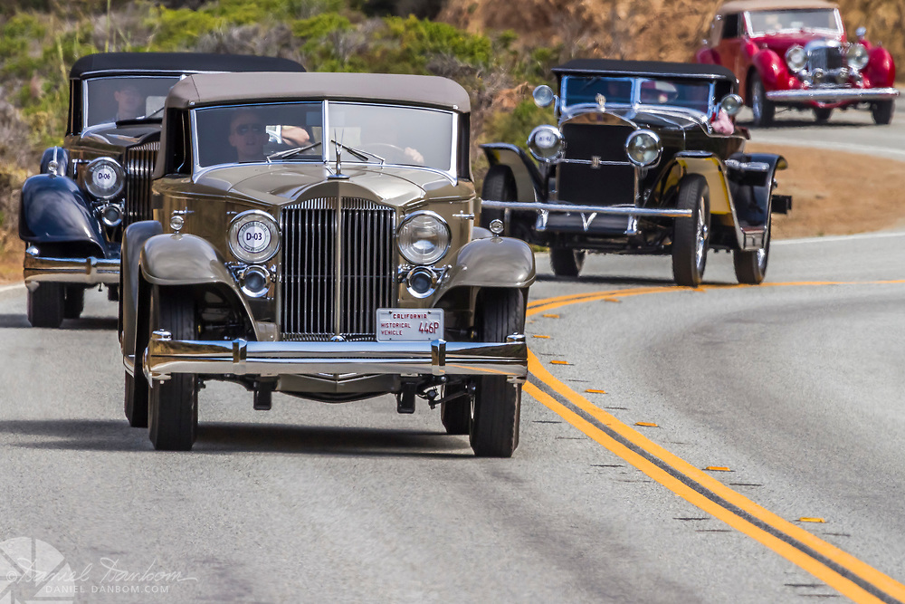 1932 Packard 906 Twin Six Dietrich Convertible Victoria  on theTour d Elegance, along Highway 1 on the Big Sur Coast. Classic and Historic autos participate in the Pebble Beach, Concours d Elegance, take to the highway to tour the Monterey Peninsula and coast.