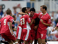 Photo: Jed Wee.<br />Hartlepool United v Swindon Town. Coca Cola League 2.<br />05/08/2006.<br /><br />Swindon celebrate with goalscorer Lee Peacock (C).