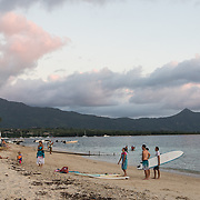 People hanging out on a white sand beach called La Preneuse Beach in a sleepy village along the southwest coast.