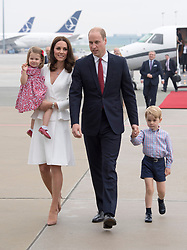 The Duke and Duchess of Cambridge arrive at Warsaw's Chopin Airport with Prince George and Princess Charlotte for the start of their five-day tour of Poland and Germany.