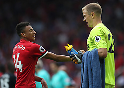Manchester United's Jesse Lingard jokes with and West Ham United's keeper Joe Hart at the end of the match