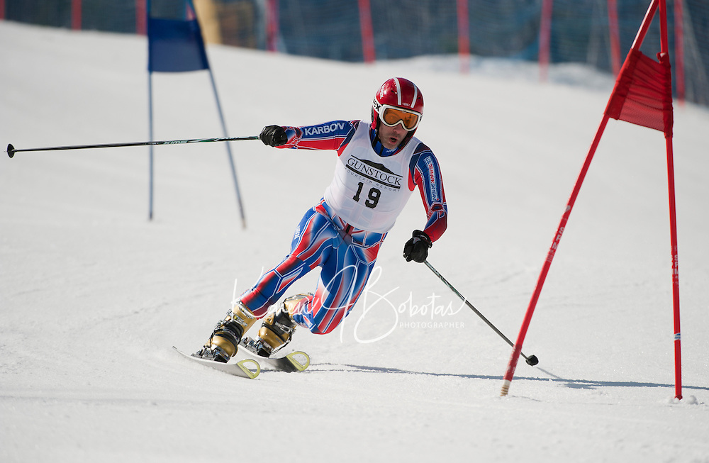 Josh Lanzetta of New Durham, NH charges the Classic course during the US Telemark Championships at Gunstock Mountain Resort on Friday.  Racing will continue through the weekend on the Tiger slope.  (Karen Bobotas/for the Laconia Daily Sun)