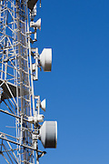 Microwave dish antenna on communications tower for the cellular telephone system. <br />