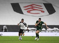 Football - 2020 / 2021 Premier League - Fulham vs Sheffield United - Craven Cottage<br /> <br /> Fulham's Ademola Lookman holds off the challenge from Sheffield United's Phil Jagielka.<br /> <br /> COLORSPORT/ASHLEY WESTERN