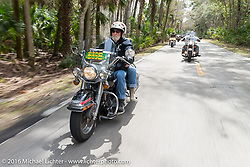 Gary and Debi Luke Riding through Tomoka State Park during Daytona Bike Week 75th Anniversary event. FL, USA. Thursday March 3, 2016.  Photography ©2016 Michael Lichter.