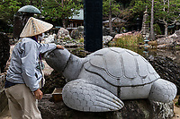 Lucky Turtle at Kongofukuji - Temple 38 Kongofuku-ji - Kongofuku-ji overlooks Cape Ashizuri and the Pacific Ocean at the tip of the Ashizuri Peninsula, it has always enjoyed the patronage of aristocrats, warriors, and noble clans like the Minamoto, Chosokabe, and Yamanouchi. Consequently it survived intact through the early Meiji years when other temples suffered damage. The temple stands in a garden of colourful stones, which are reflected in a large pond. There are numerous pines, and the hill behind the temple is cloaked in windswept trees.Cape Ashizuri is the southernmost point of Shikoku, infamous throughout Japan for its fierce and changeable weather. Kogofukuji is also one of the most dramatic and picturesque of all the 88 temples, thanks to its remote location overlooking Cape Ashizuri.