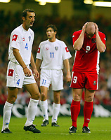 Photograph: Scott Heavey.<br />Euro 2004 Group 9 Qualifying match.<br />Wales v Serbia and Montenegro. 11/10/2003.<br />John Hartson tries to block it all out