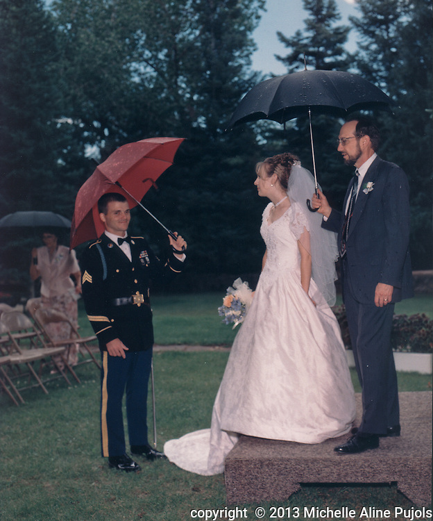 The wedding party waiting for the rain to stop.