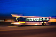 Public bus route 205, operated by RTD (Region Transit Denver), speeds down 28th Street at night in Boulder, Colorado.