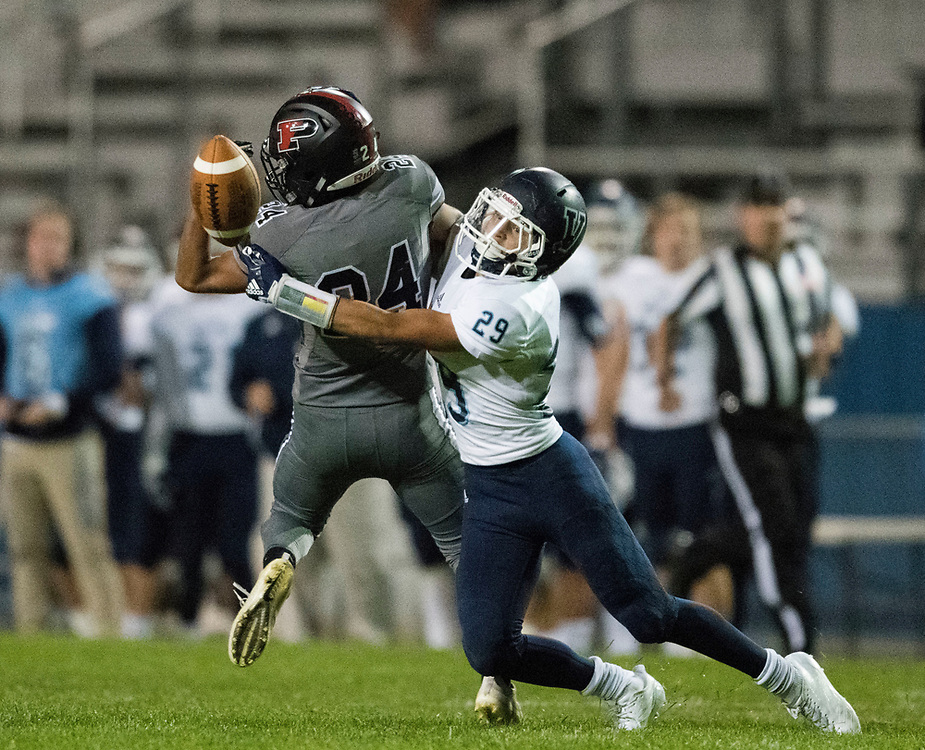 ARVADA - SEPT. 22: Valor Christian's Chase Lopez, right, breaks up a pass intended for Pomona's Kenny Maes during the second half of a Class 5A nonconference high school varsity football game held at the North Area Athletic Complex. Lopez's coverage received a pass interference penalty during the play. (Photo by Andy Colwell/ Special to The Denver Post)